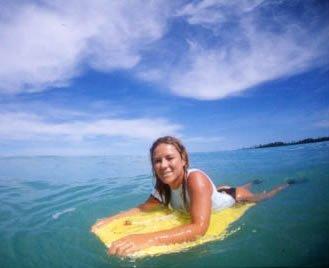 Karina in the water on her bodyboard