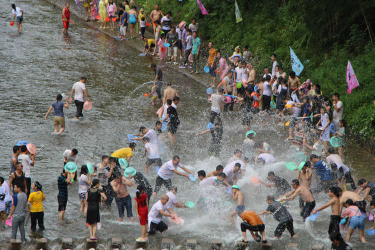 People in a river at the Songkran Festival