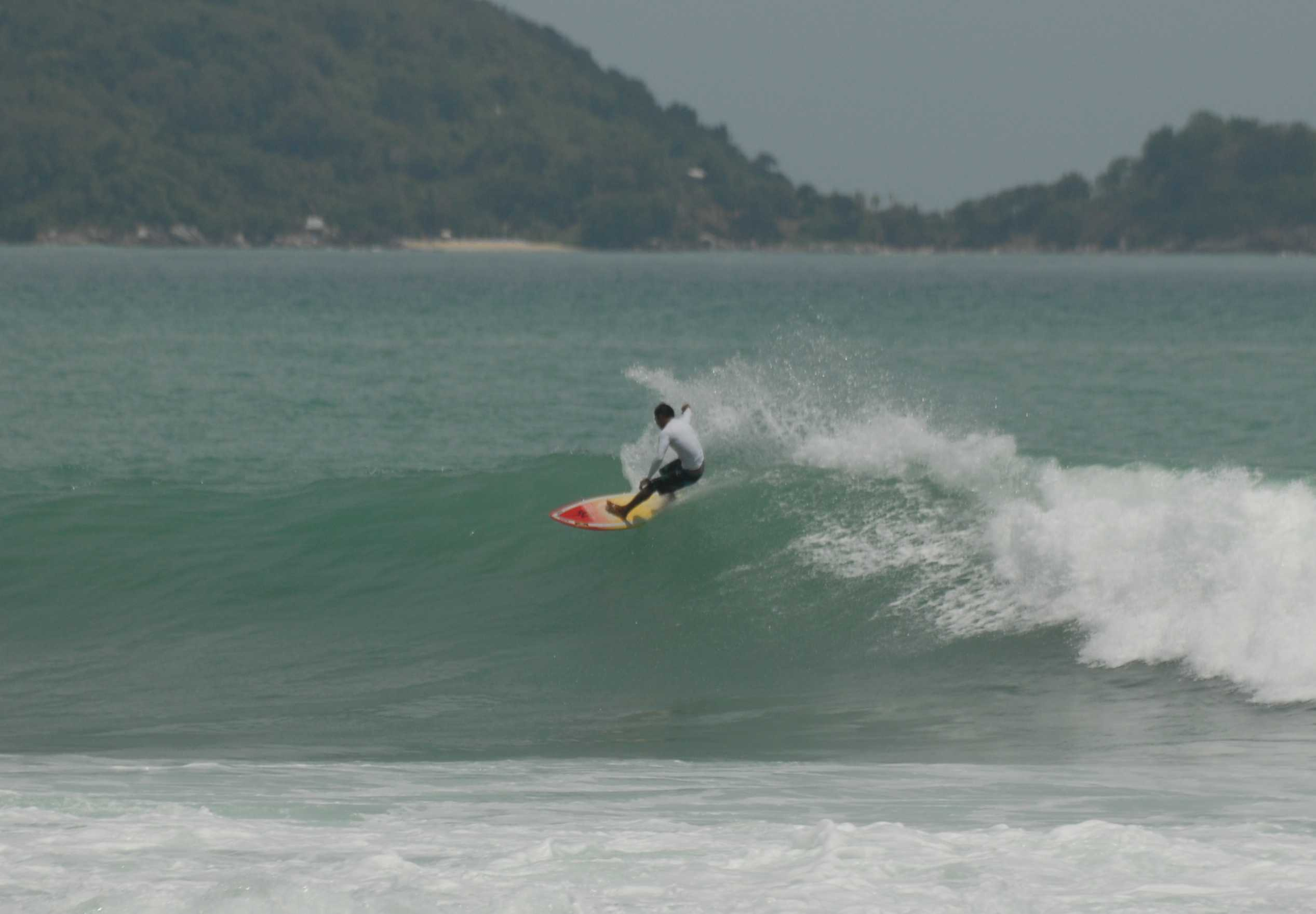 Surfing Kalim Beach