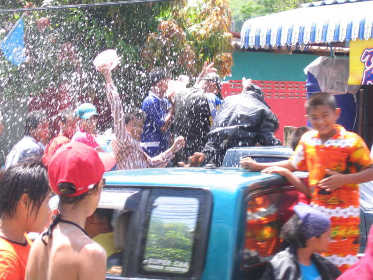 People throwing water from cars
