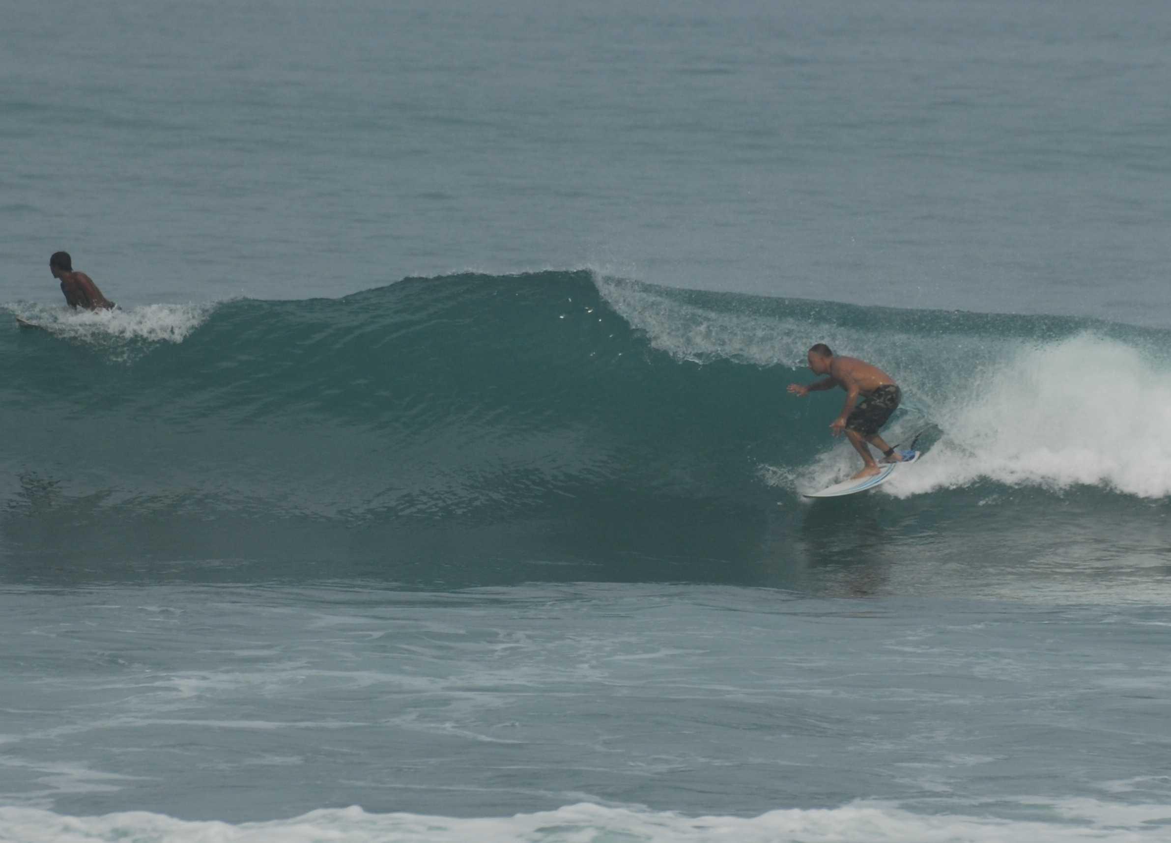 Surfing Kalim Reef