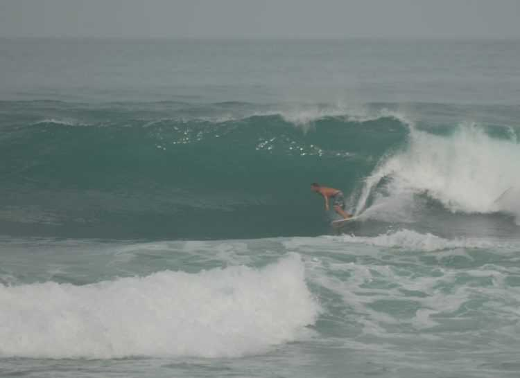 Surfing Kalim Reef